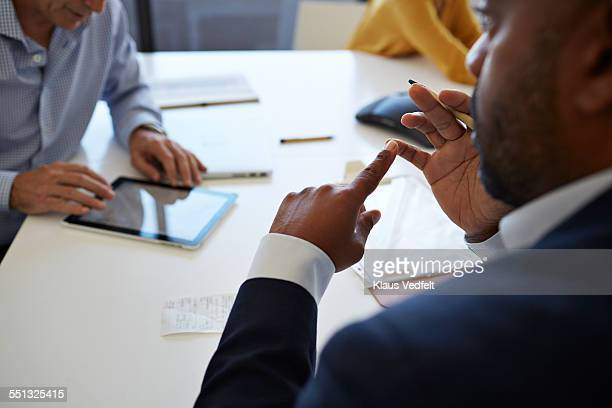 Close-up of businessmans hands explaing at meeting