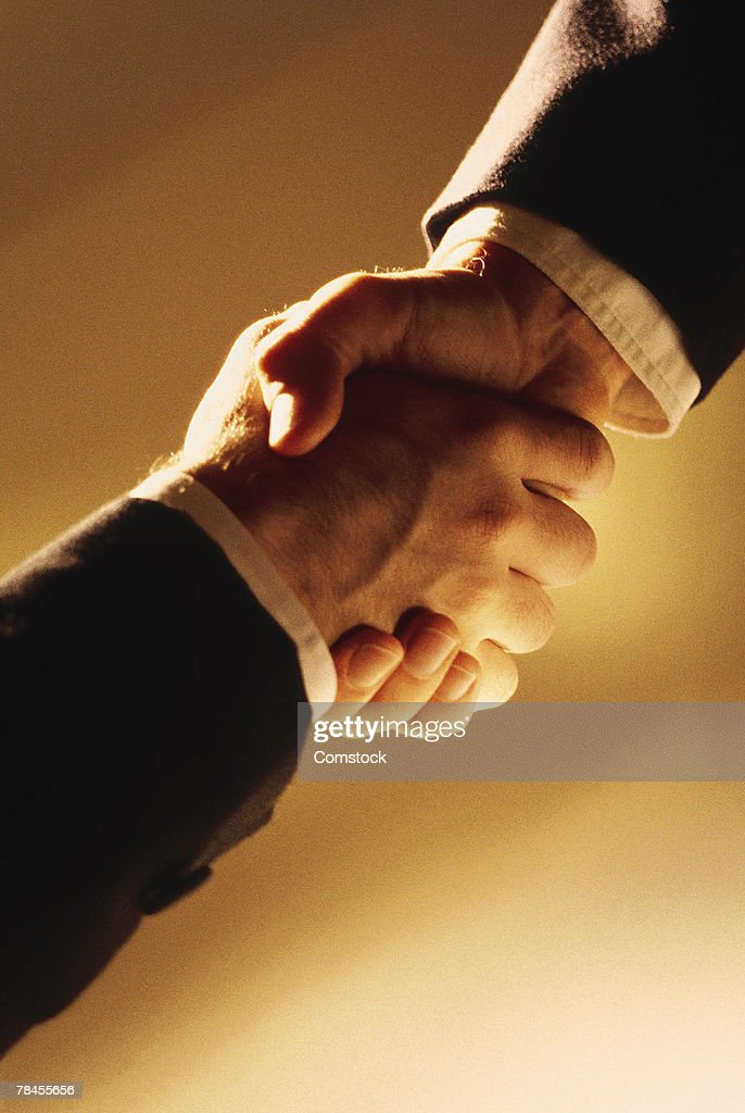 Close-up of businessmen shaking hands : Stock Photo