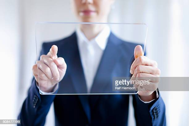 Close-up Of Businesswoman Touching On Blank Futuristic Digital Tablet