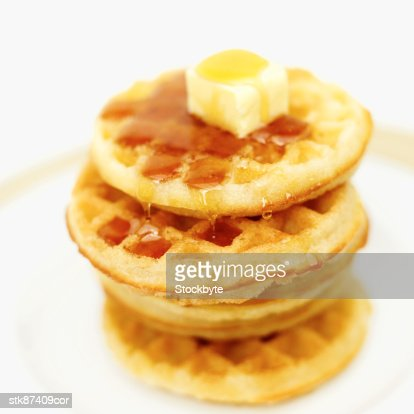 close-up of butter melting on stack of waffles