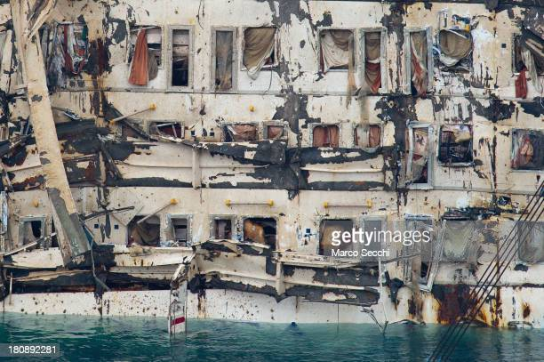 A closeup of cabins on the severely damaged side of the stricken Costa Concordia after the parbuckling salvage operation successfully uprighted the...