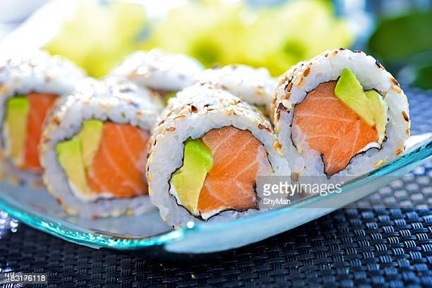 Closeup of California maki sushi rolls on a glass plate