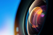 Camera Lens. Shallow depth of field. Focus on the lens surface.