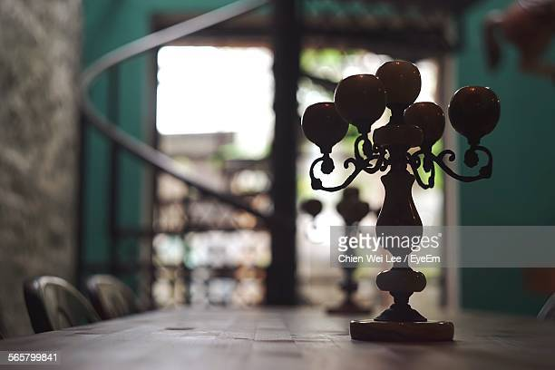 Close-Up Of Candle Holder On Wooden Table