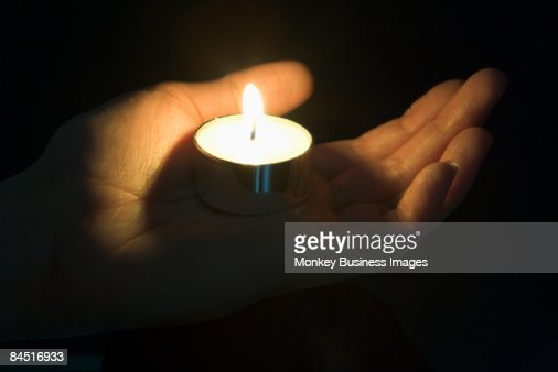 Close-Up Of Candle In The Palm Of A Persons Hand : Foto de stock