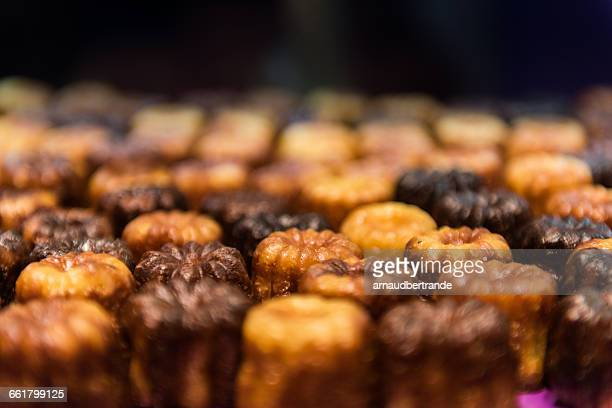 Close-up of canele cakes in a row