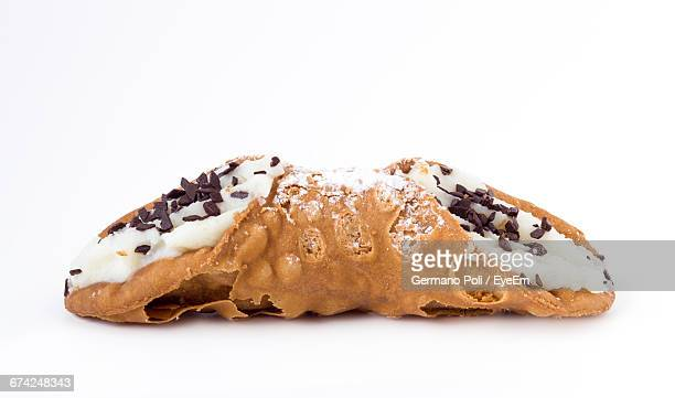 Close-Up Of Cannoli Against White Background