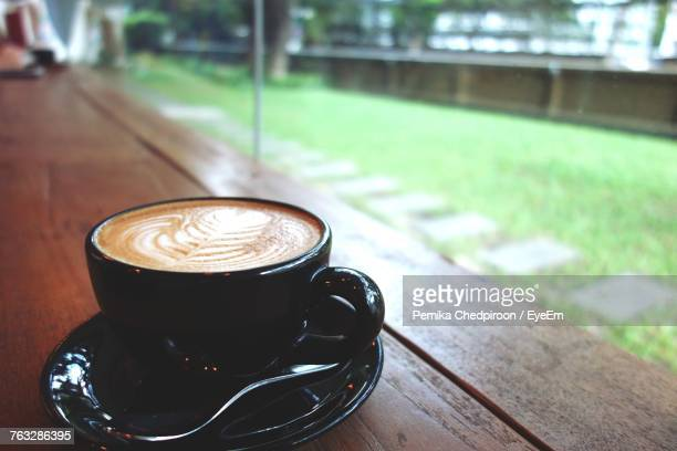 Close-Up Of Cappuccino On Wooden Table