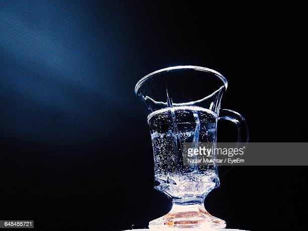Close-Up Of Carbonated Water In Glass Against Wall