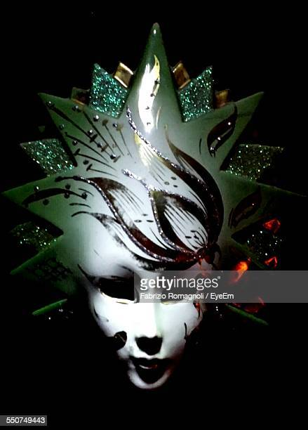 Close-Up Of Carnival Mask In Darkroom