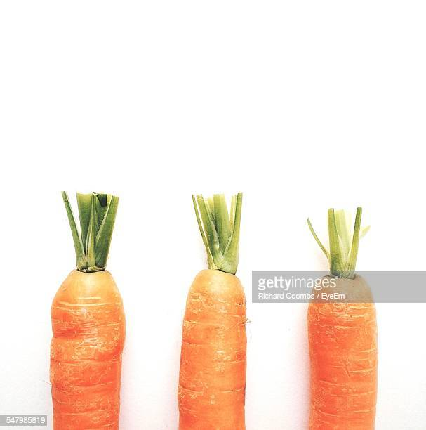 Close-Up Of Carrots Over White Background