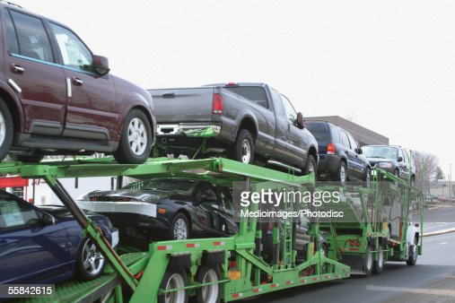 Close-up of cars on top of a truck
