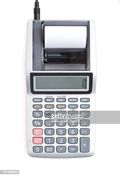 Close-Up Of Cash Register Over White Background