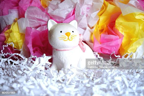 Close-Up Of Cat Figurine Amidst Decorations
