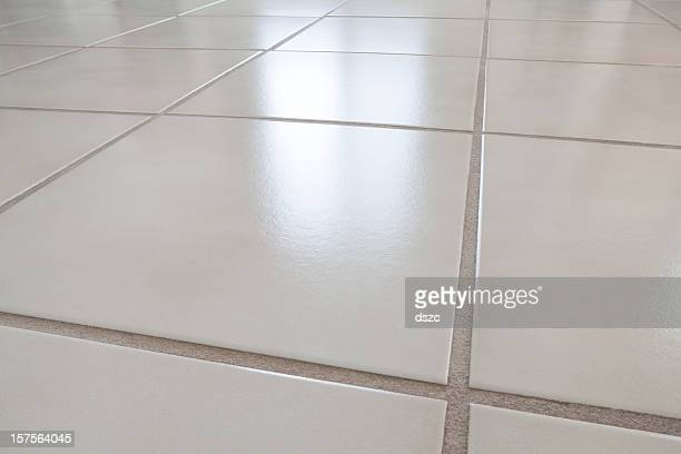 closeup of ceramic tile floor with reflection from window