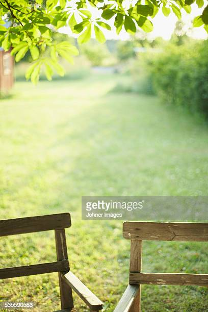 Close-up of chairs in garden