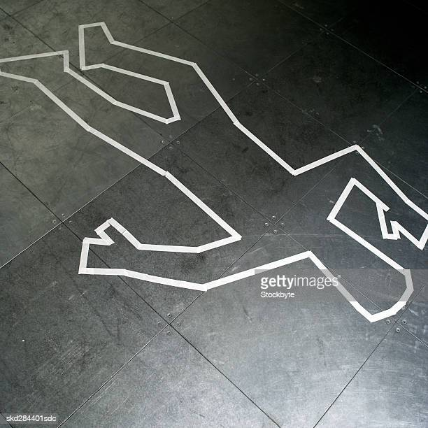 Close-up of chalk outline of body