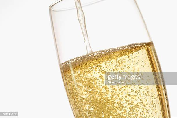 Close-up of champagne being poured into a champagne flute