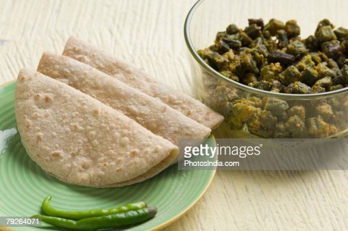 Close-up of chapattis in a plate with cooked okra