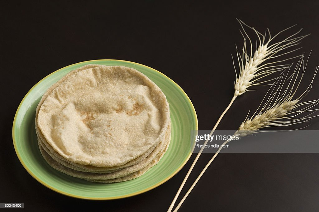 Close-up of chapattis in a plate with wheat husks