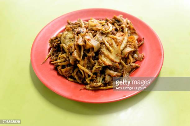 Close-Up Of Char Kway Teow Served In Plate On Table