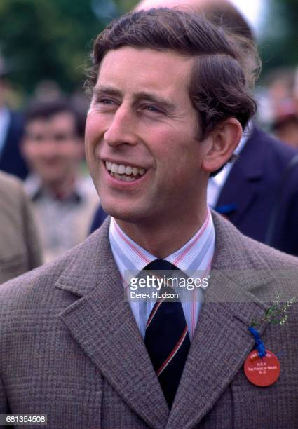 Closeup of Charles Prince of Wales dressed in a tweed jacket striped shirt and tie and with a sprig of heather in his lapel as he attends an...