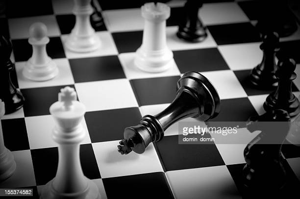 Close-up of Checkmate move on chessboard in black and white