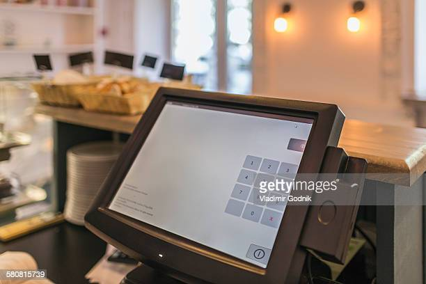 Close-up of checkout counter in coffee shop