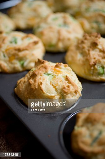 Close-up of cheddar cheese and ham muffins in pan