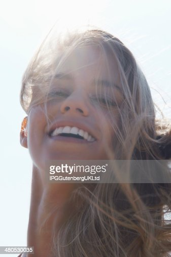 Closeup Of Cheerful Woman With Windy Hair : Stock Photo