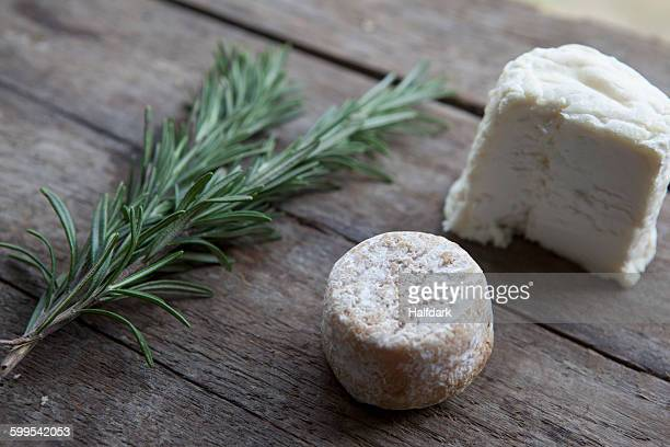 Close-up of cheese and rosemary on table