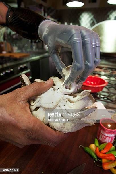 Closeup of chef with prosthetic hand and mushrooms
