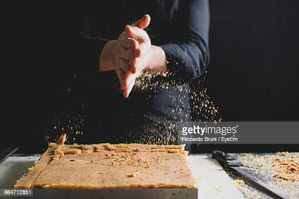 Close-Up Of ChefS Hands Preparing Sponge Cake