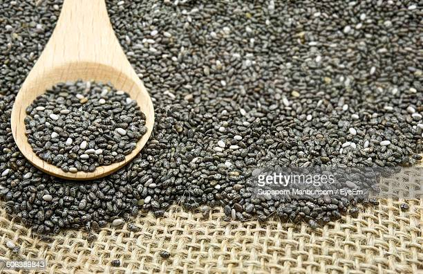 Close-Up Of Chia Seeds In Spoon And Table