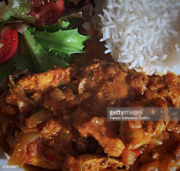 Close-Up Of Chicken Curry And Rice On Plate At Home