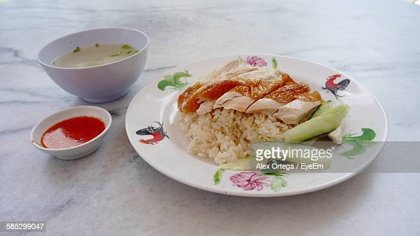 Close-Up Of Chicken Rice Served In Plate