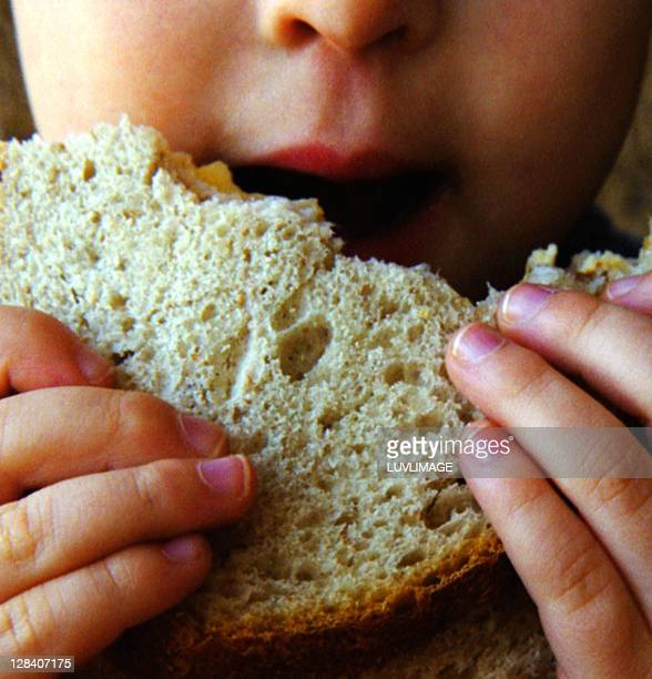 close-up of Child eating sandwich