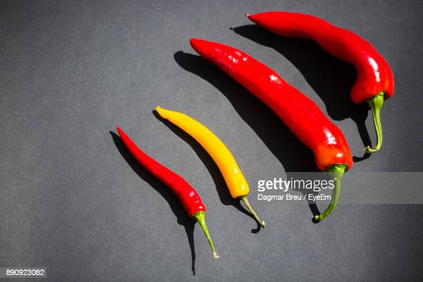 Close-Up Of Chili Peppers Against Gray Background