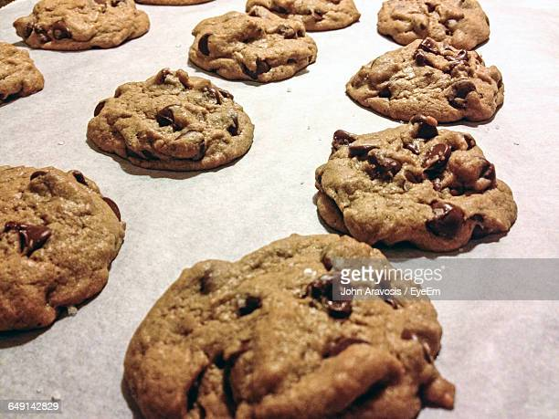Close-Up Of Chocolate Chip Cookies On Baking Sheet