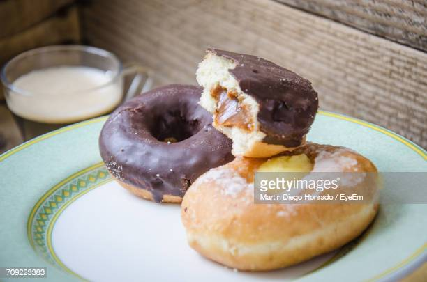 Close-Up Of Chocolate Donuts In Plate