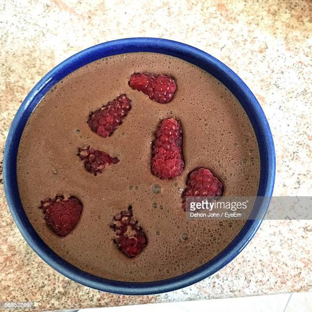 Close-Up Of Chocolate Shake Served With Raspberries