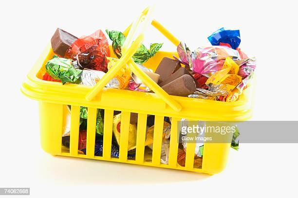 Close-up of chocolates and gifts in a basket