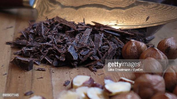 Close-Up Of Chopped Chocolate And Chestnuts On Cutting Board