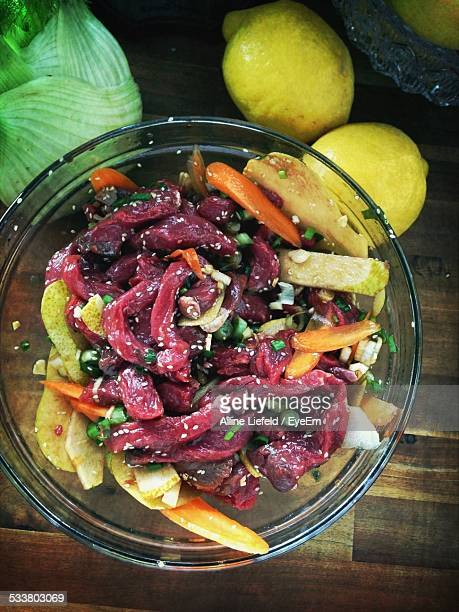 Close-Up Of Chopped Vegetables And Jerky In Bowl