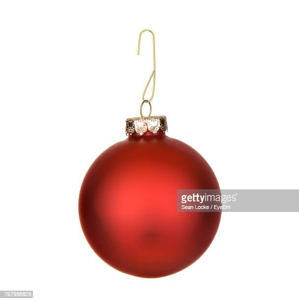 Close-Up Of Christmas Decoration Hanging Over White Background