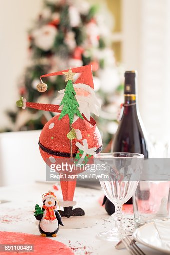 Close-Up Of Christmas Decoration On Table At Home