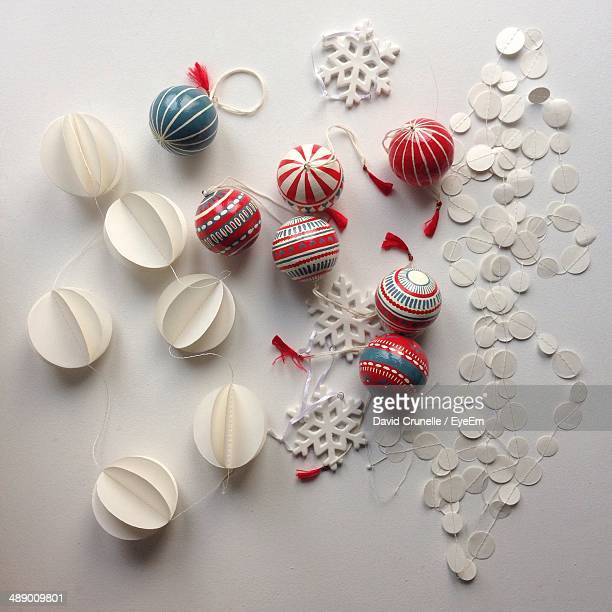 Close-up of Christmas decorations on white surface