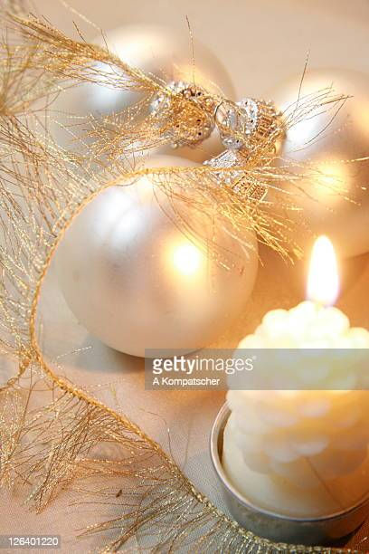 Close-up of Christmas ornaments with burning candle