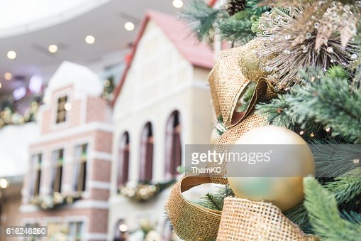 Closeup of Christmas tree with ornaments and home background : Stock Photo