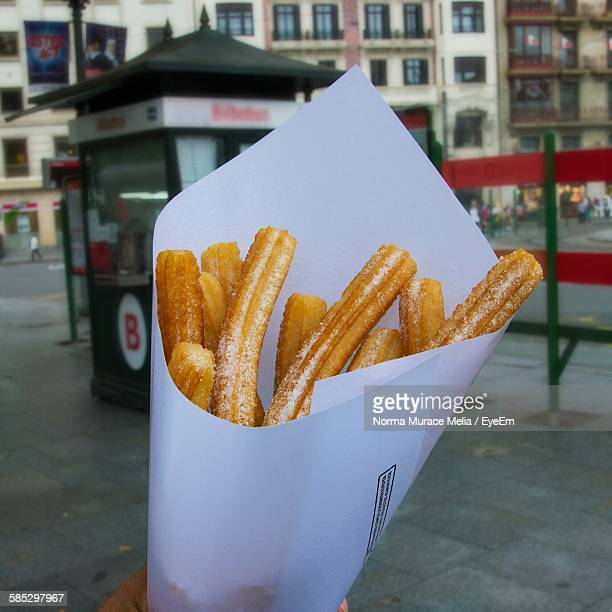 Close-Up Of Churros In Paper Container